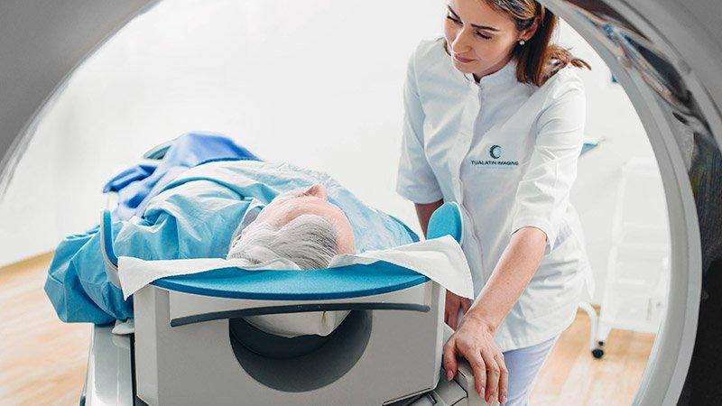 A medical practitioner provides diagnostic imaging services